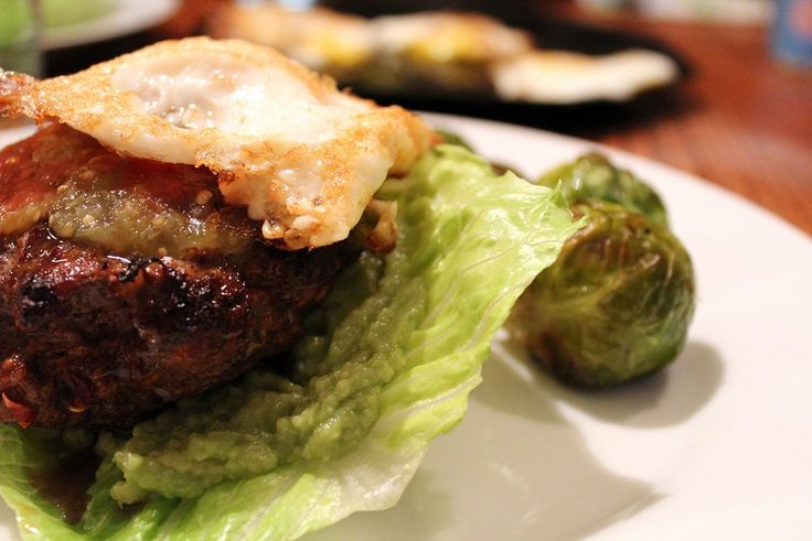 The Paleo Parents present their chorizo venison burgers topped with fried egg and guacamole, of course.