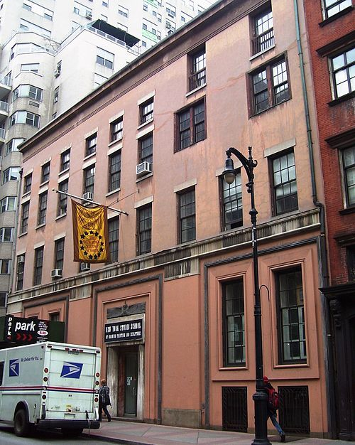 The Whitney Museum of American Art's original location, at 8–12 West 8th Street, between Fifth Avenue and MacDougal Street; and currently the home of the New York Studio School of Drawing, Painting and Sculpture.