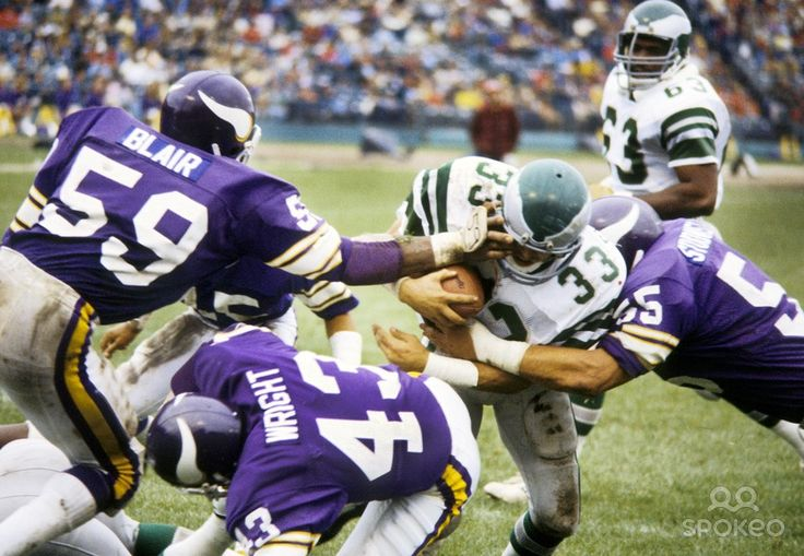 Philadelphia Eagles running back Louie Giammona (33) is tackled by Minnesota Vikings linebackers Matt Blair (59) and Scott Studwell (55) at Metropolitan Stadium.