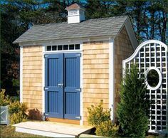 """10' x 10' Stony Brook Saltbox - Shown with 4' double 2 panel beaded doors with 4' p.v.c. transom window over for added light. To accommodate a transom window over a door as pictured, this building has a raised wall height of 88"""". Standard hardware; standard craftsman trim painted white. White cedar shingle siding on all 4 walls; upgraded architectural roofing and 16' copper top cupola."""