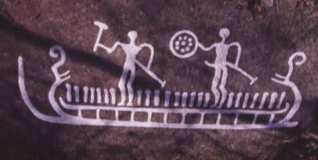Rock carving from Svenneby, Bohuslän in Sweden. One of the persons on board the sun ship holds a sun symbol, however, it also resembles a Bronze Age shield. The small strokes representing the ship's crew could be the souls of the dead rowing the sun ship