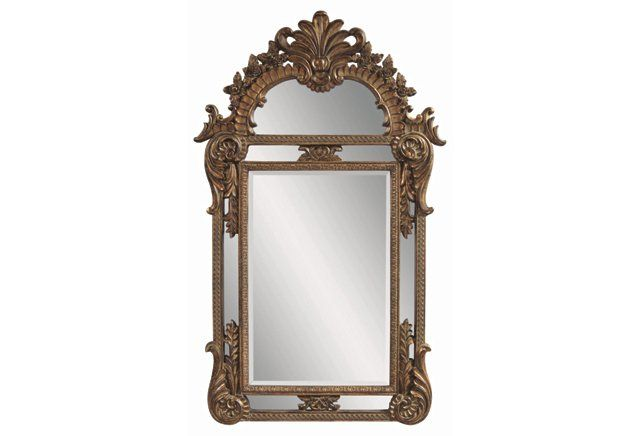 This ornate gold floor mirror couldn't get any more glamorous!
