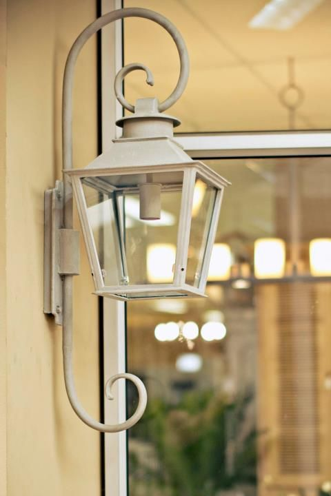 Our Lavignon petite lantern with French curl detail in the French White colour finish.