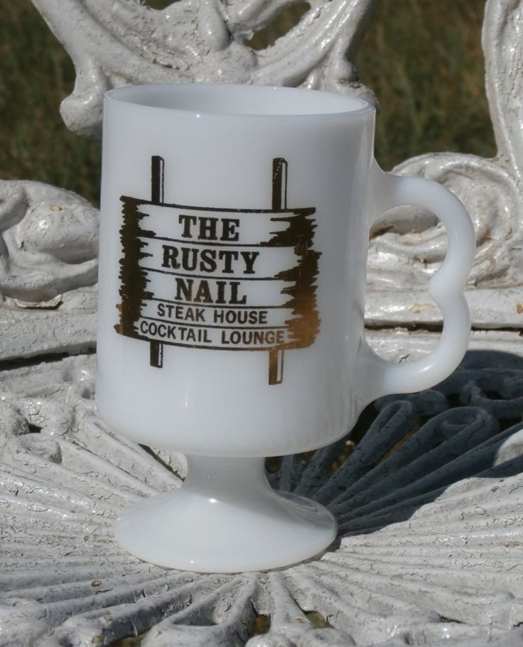 The Rusty Nail Steak House and Lounge Footed Coffee Mug Cup White and Gold Milk Glass Advertising Mug