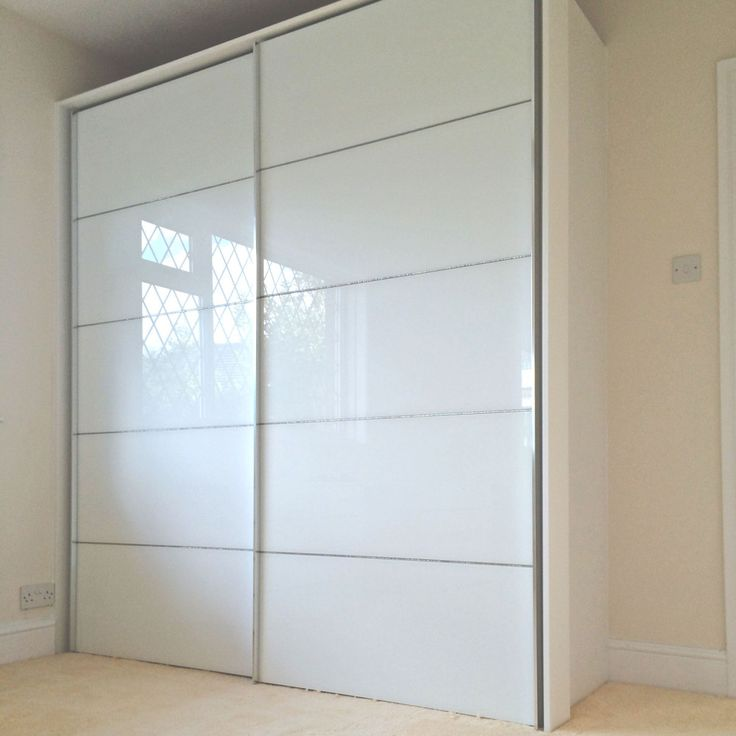 White glass sliding wardrobe with swarovski crystals- Nolte Delbruck