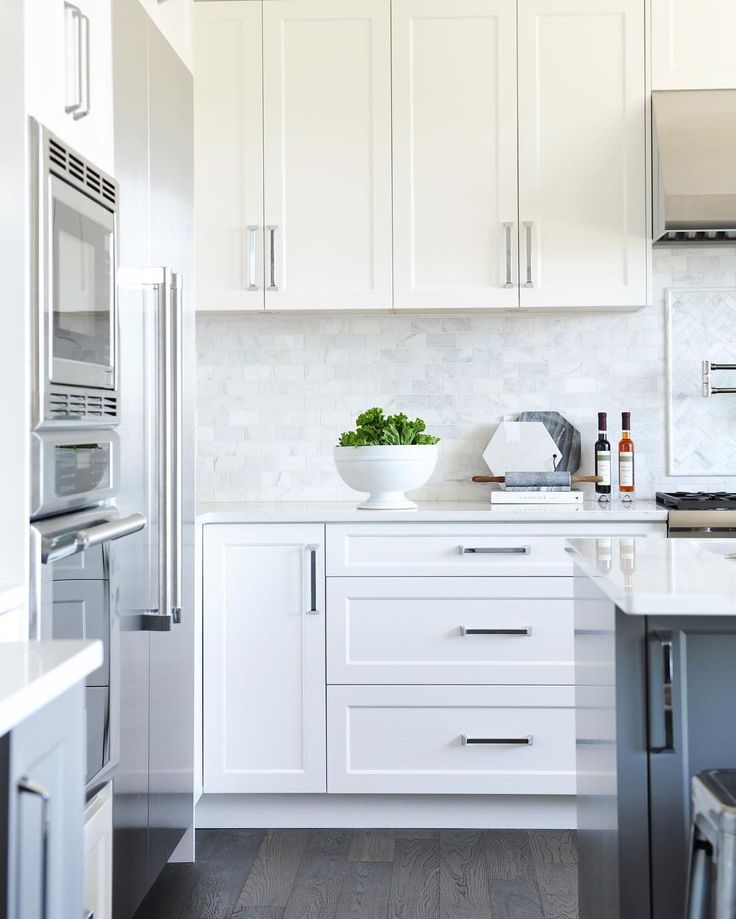 "Amanda Evans on Instagram: ""I love this kitchen! White shaker panel cabinets + a dark grey island + a marble backsplash by @tracey_ayton"""