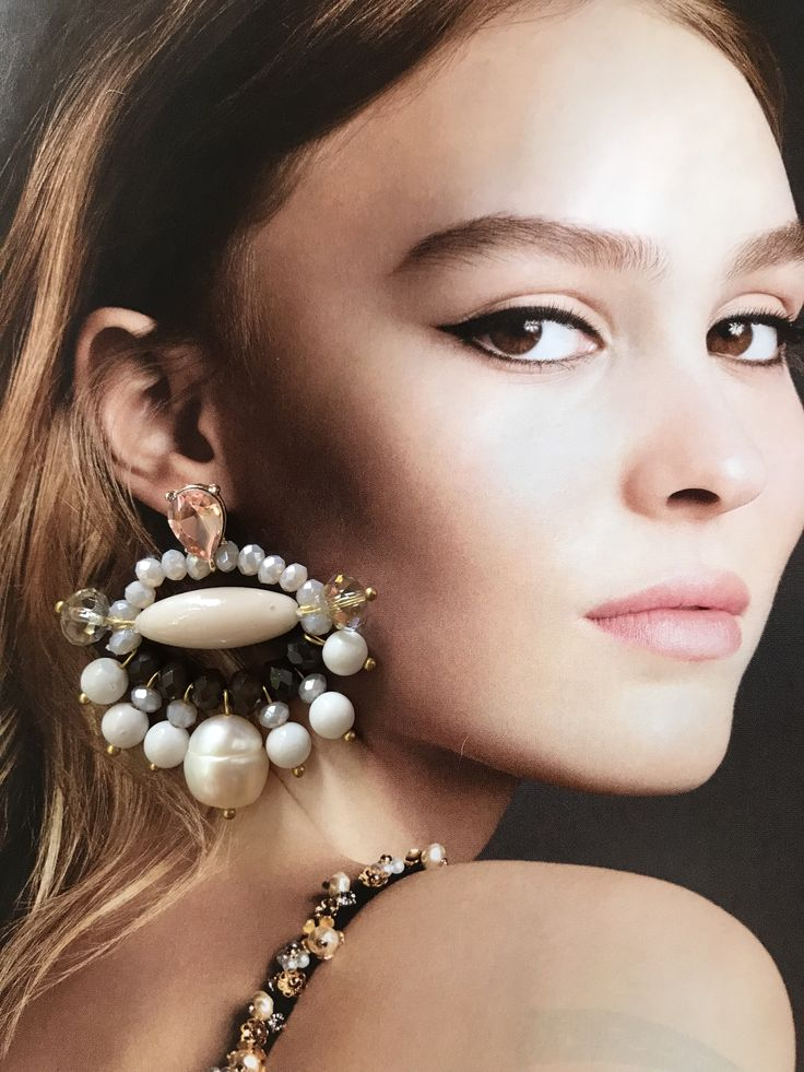These are the 'keepin it classy' earrings. I had to lay them on this pic in the magazine. This woman is so beautiful. Jade, pearls, crystals...