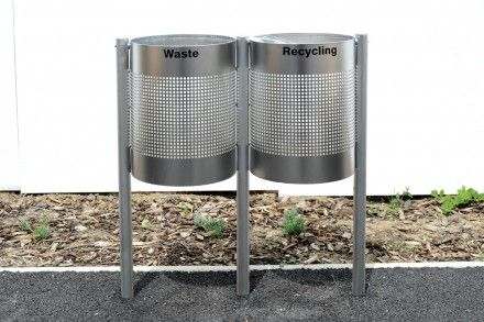 Stainless steel circular post mounted recycling containers, comprising two containers with round perforations and lockable aluminium liner.