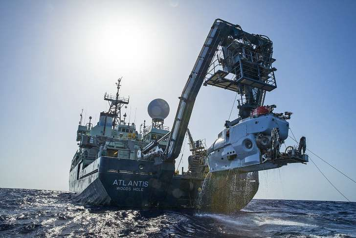 In this image released by, The Woods Hole Oceanographic Institution, the research vessel Atlantis is shown off the coast of the Carolinas in the Atlantic Ocean during the second week of July 2015 with the submersible Alvin hanging off its stern. The expedition led by Duke University marine scientist Cindy Van Dover has found a shipwreck that may date back to the late 1700s.
