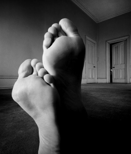 Bill Brandt Only the feet of the model are visible - foreshortening means that the body is completely hidden and gives the impression that the room is filled by two gigantic feet. How has the photographer used light and shadow to help make the feet look so large?