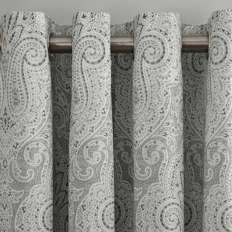 Featuring a printed paisley pattern, these grey eyelet curtains have a thermal lining to regulate temperature and are available in a range of drops....