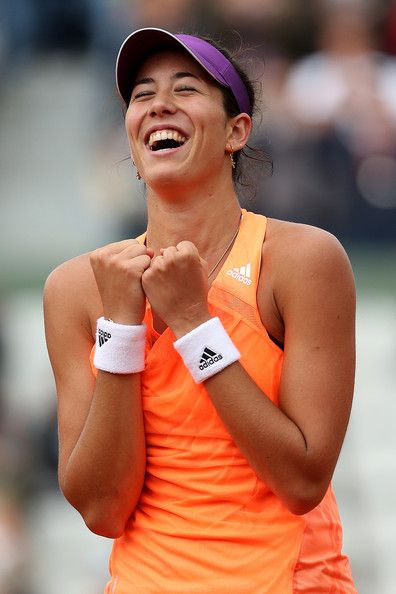 Garbine Muguruza of Spain celebrates her victory in her women's singles match against Serena Williams of the United States on day four of the French Open at Roland Garros on May 28, 2014 in Paris, France.