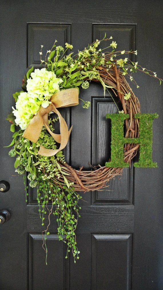 wreath for front door: grapevine wreath with live branches and greenery + burlap ribbon (nix the initial...yuk!)