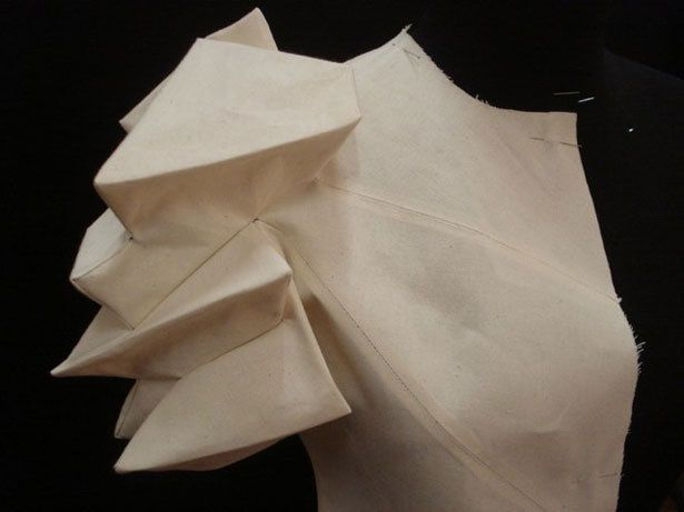 Sculptural sleeve made by manipulating fabrics into 3D shapes using Shingo Sato's transformational reconstruction technique; creative sewing