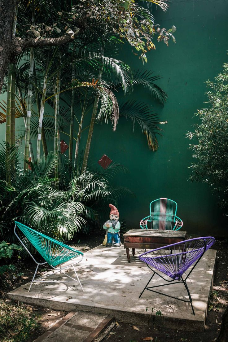 Outdoor garden, terrace, Acapulco chairs, garden gnome, tropical patio