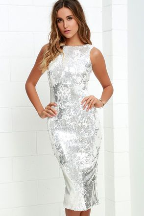 Shine bright (like a diamond!) in the Dress the Population Audrey White and Silver Sequin Midi Dress! Mirrored sequins flow beautifully from a rounded neckline into a sleeveless, darted bodice with a sexy V back. Bodycon silhouette ends at a midi-length hem with kick pleat. Hidden back zipper.