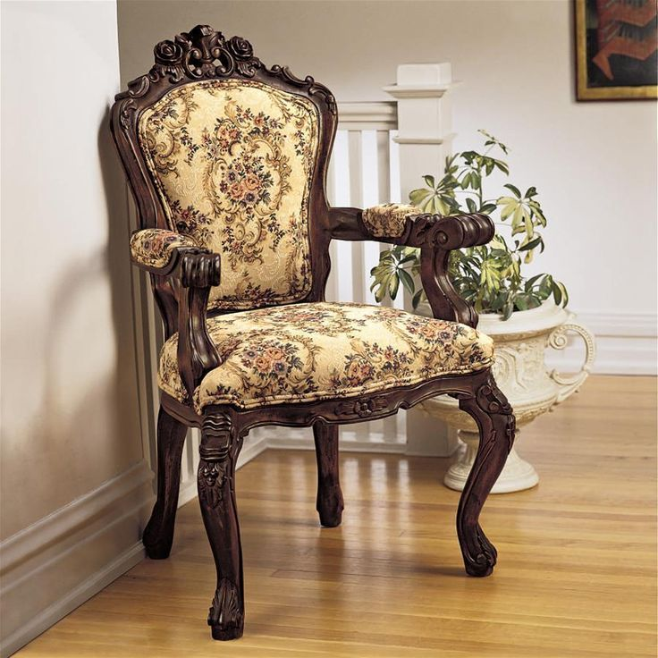 "Taking over a week to hand-carve, the roses, leaves and shells found throughout the rich solid mahogany of this chair give it a distinctly Baroque feel. Hand-upholstered front and back and double welted in a Tudor-style jacquard tapestry of rich golds and burgundies. Place our exclusive work of furniture art in your home, library or office to garner raves for its style and comfort.24""Wx20""Dx41""H. 20 lbs."