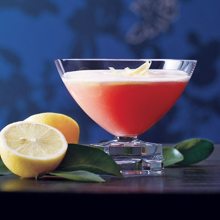 Mediterranean Pink Lady:  1 1/2 ounces gin, preferably London dry 1/2 ounce Cointreau or other triple sec 1/4 ounce limoncello 1/4 ounce Campari 1/2 ounce fresh lemon juice 1 large egg white 3 or 4 thin strips of lemon zest, for garnish