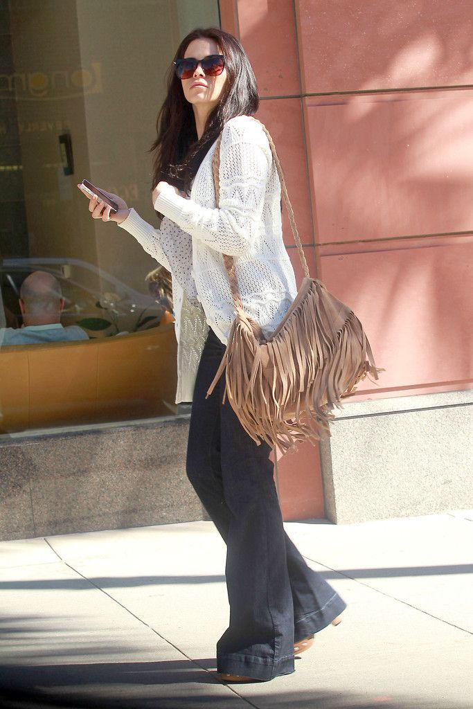 Jenna Dewan, wife of actor Channing Tatum, arrives at Anastasia's Salon in Beverly Hills carrying a leather, fringe purse. After her salon visit, Dewan went over to Saks Fifth Avenue for a bit of retail therapy.