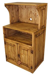 Our rustic microwave stand is a creative solution to the problem of where to put your microwave oven, and it provides extra kitchen storage. The microwave oven fits into a large cubby up top. Directly below the microwave is another cubby, perfect for cookbooks. Two beveled, bottom doors hide extra space that can store cookware. Side panels match the doors.   LaFuente.com