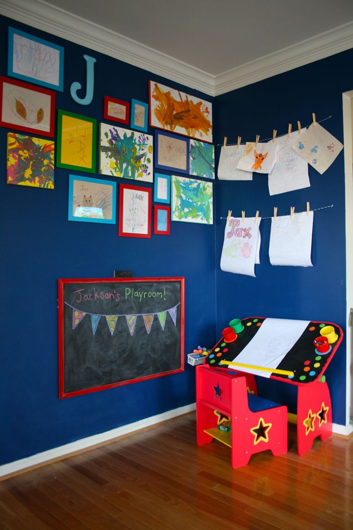 The $2 Toddler Art Gallery.  I love how special pieces are framed in a more permanent, but playful way, and new items can be hung on the wall right away with the clothespins.