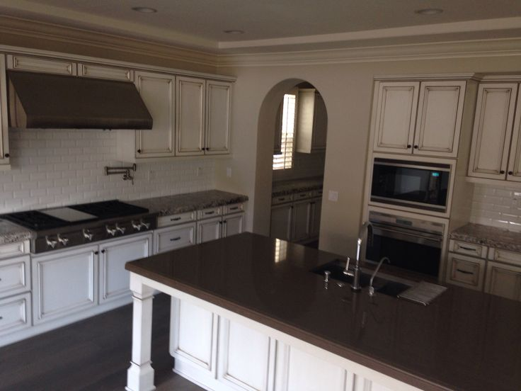 Kitchen With Bianco Antico Granite At Perimeter Counters