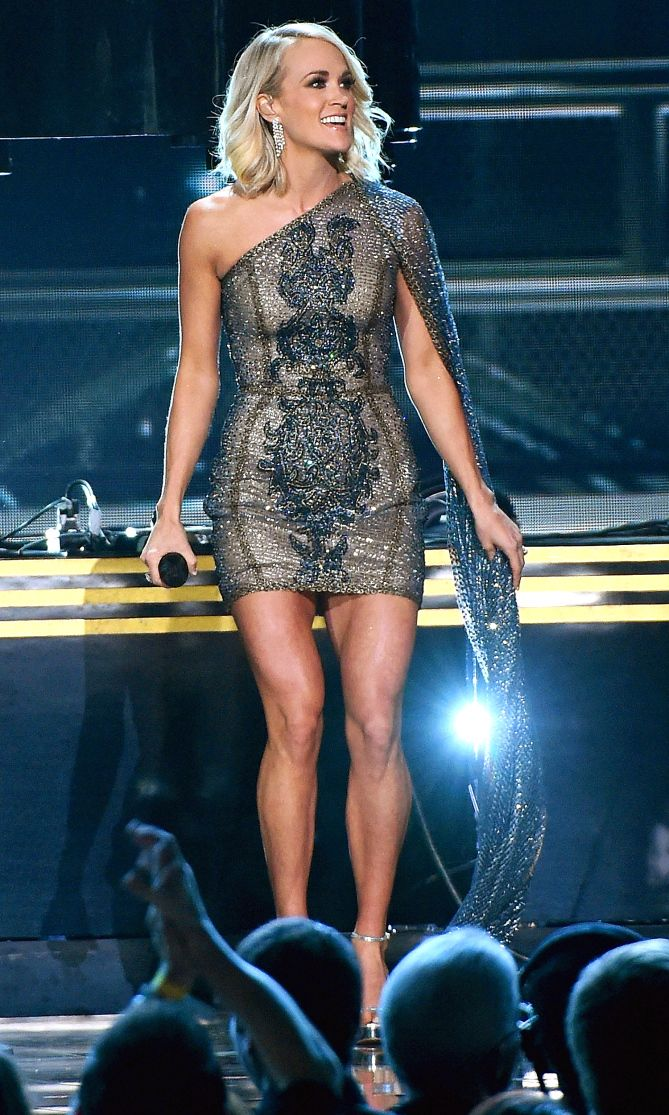 Carrie Underwood in a one-shoulder beaded Elie Madi dress - click through to see all of her 2016 CMAs looks!