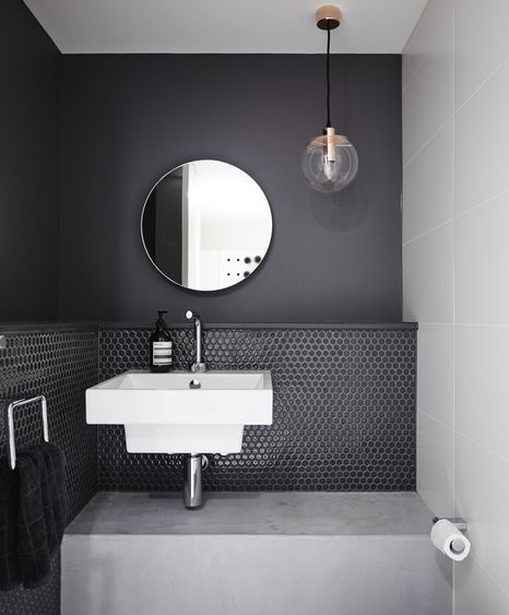 Grey bathroom wall and round mirror - nice. (Pleysier Perkins)