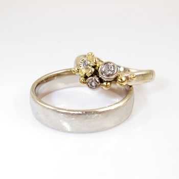 Galleri Castens - Wedding rings with flowers and diamonds