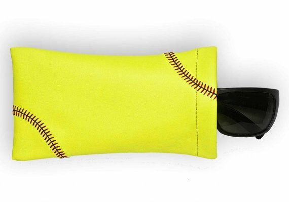 This softball sunglass pouch is created from actual softball leather, and features softball stitching. If you love softball, use the only sunglass pouch made from actual softball material with real stitching accents! Fits easily into any purse or bag.