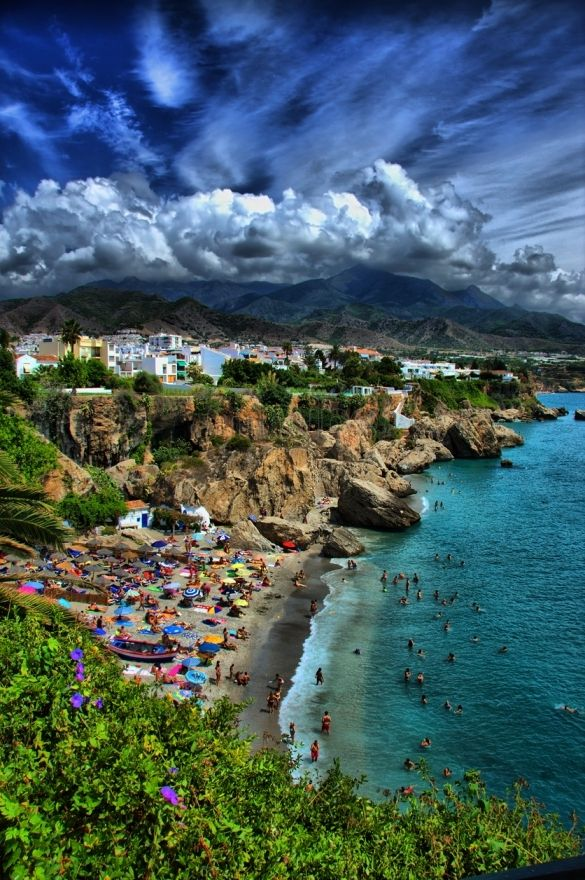 The Balcon de Europa in Nerja, Spain is one of the most beautiful spots in Andalucia. It's a viewpoint where you can see the Mediterranean coast, charming white houses of Nerja, and simply amazing sunsets. http://www.minube.net/place/balcon-de-europa--a9847