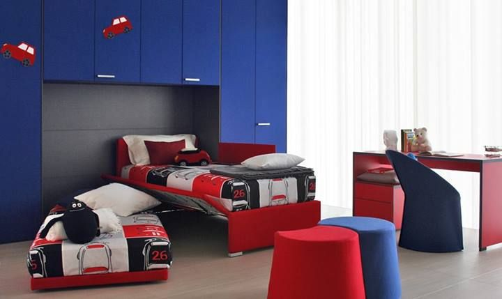 "So that his bedroom is always special and can change with him as he grows [""Biss"" by Flou. Trundle Bed with removable cover. Design by Pinuccio Borgonovo. Various fabric options available] #Bedroom #InteriorDesign #HomeDecor #Design #Arredamento #Furnishings #red #blue #kids #child #children"