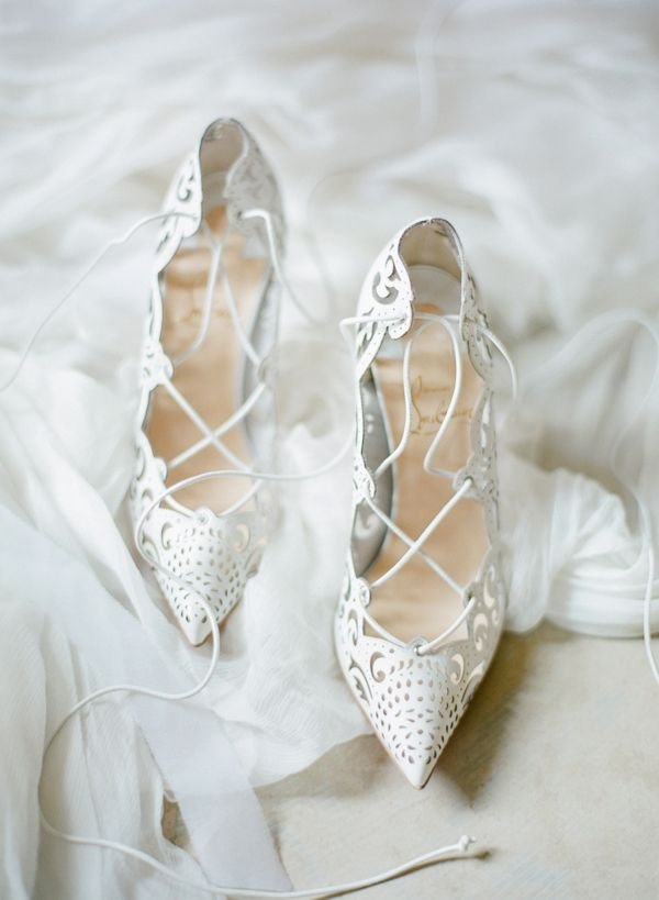 FOR THE ACCESSORIES || Cut out white lace detail lace up Louboutin points || NOVELA...where the modern romantics play & plan the most stylish weddings...Instagram: @novelabride www.novelabride.com