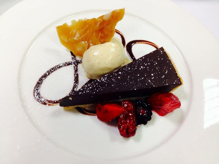 Traditional dark chocolate torte with house made coconut ice-cream and forests berries