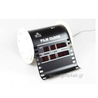 Ψηφιακό επιτραπέζιο ρολόι σε σχήμα παλιού φιλμ κινηματογράφου. Λειτουργεί με το ρεύμα και δείχνει ψηφιακά την ώρα και την ημέρα.