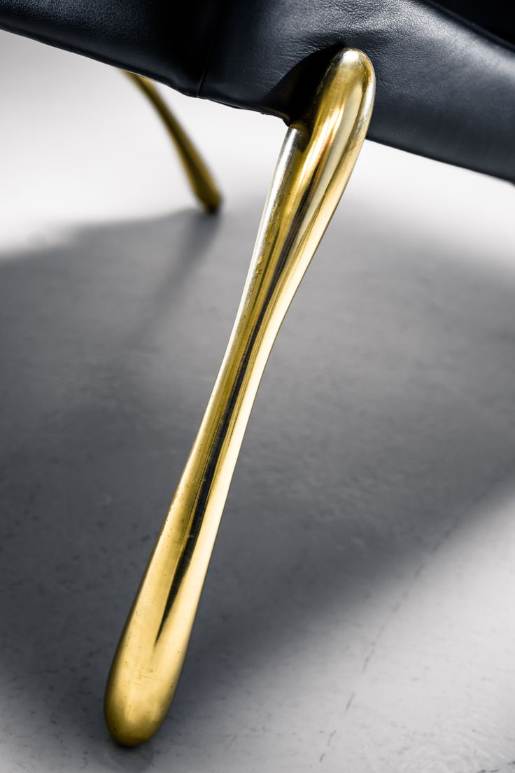 Jeff lounge chair by Ateljé Sotamaa. 3D printed and solid cast brass legs with an Italian leather upholstered seat.