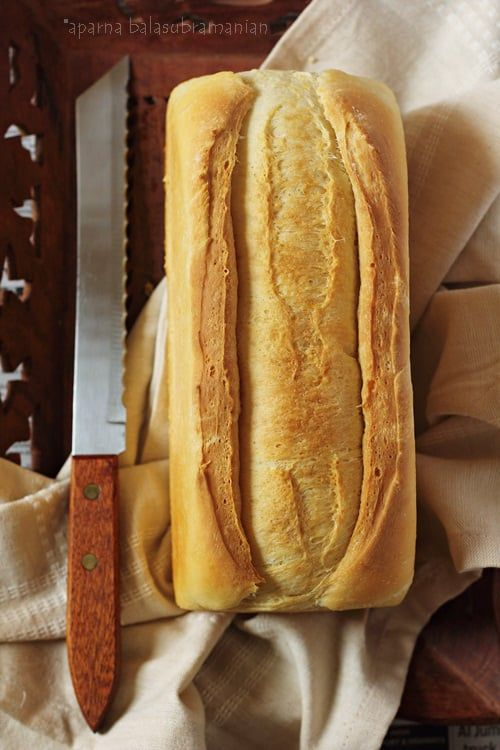 """A mildly sweet sandwich bread with a buttery crust that is soft and just dense enough to hold up to slicing. Typically, it has a long slash down the middle of the length of the loaf into which melted butter is poured just before baking it. This gives this bread its distinctive golden """"buttercrust."""