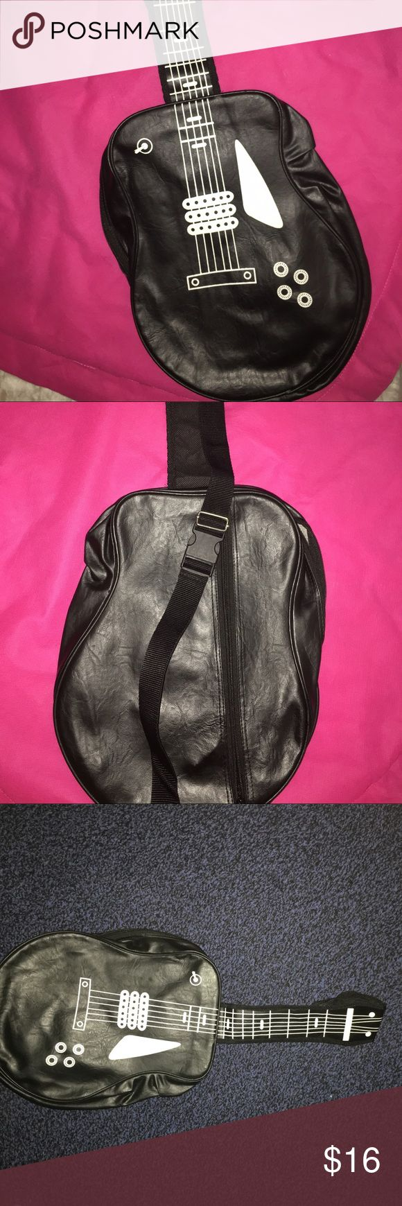 🎸🎸Guitar Cross Body Bag🎸🎸 Good condition, no stains inside the bag but there are white flakes on the outside of the bag-refer to the last photo. The bag is pretty roomy and fits my 10 inch tablet with more room to spare. The strap is adjustable. Sling this cool bag over your shoulder or wear it as a crossbody!! Offers are welcomed!!! Bags Crossbody Bags