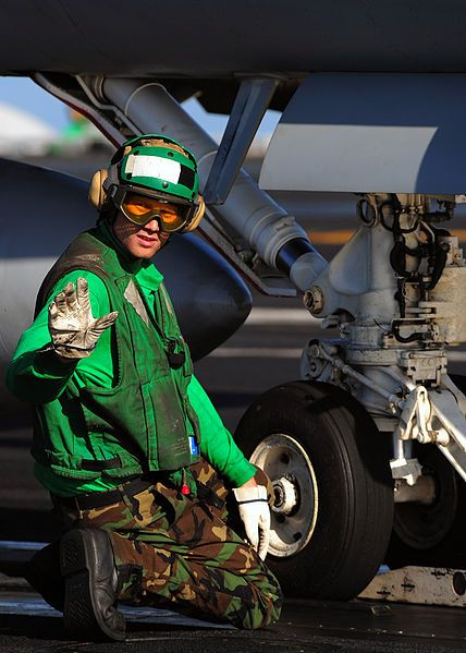 File:US Navy 090216-N-7571S-013 Aviation Boatswain's Mate (Equipment) 2nd Class Marc Rohloff waits for the signal from an Aviation Boatswain's Mate (Handling) to apply tension before an aircraft launch aboard the aircraft carrier US.jpg - Wikimedia Commons
