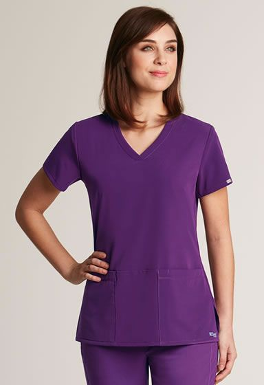 "Grey's Anatomy Signature Women's Criss Cross V-Neck #2115.  This top will become your new fav! This slenderizing top is sure to give you compliments.  Junior Fit.  3 Pockets.  Criss Cross v-neckline.  Hidden PDA pocket.  Fitted Back.  Sizes: XXS-5XL.  Medium Length: 26"".  Colors: White, Black, Indigo, Dewberry, and Electric Blue http://www.nationalscrubs.com/Greys-Anatomy-Signature-Womens-Criss-Cross-v-neck-p/bc2115.htm"