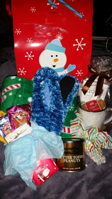 Adult Christmas Eve Box.....holiday blankey, slippers, tea/cocoa cup set with Biscoff cookies, butter toffee peanuts, and variety of flavored cocoa mixes with mini cordials. Merry Christmas!