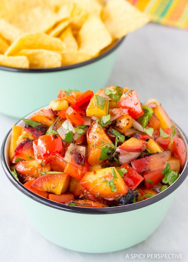 Grilled Chipotle Peach Salsa Recipe - A fresh spicy-sweet salsa recipe perfect for dipping! Spoon peach salsa over fish or chicken for a perky topping!