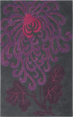 EXCLUSIVE. Plum perfect: standout shades of contemporary wine and fuchsia are sculpted into the slate background of this modern rug. 100% wool with a 100% cotton backing. Hand tufted. Swatches and non-skid area rug pads are available.