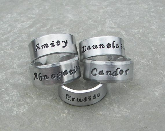 Hey, I found this really awesome Etsy listing at http://www.etsy.com/listing/124583811/hand-stamped-divergent-factions-ring-set OMG OMG THIS IS AMAAAAZZZIIINNGGG