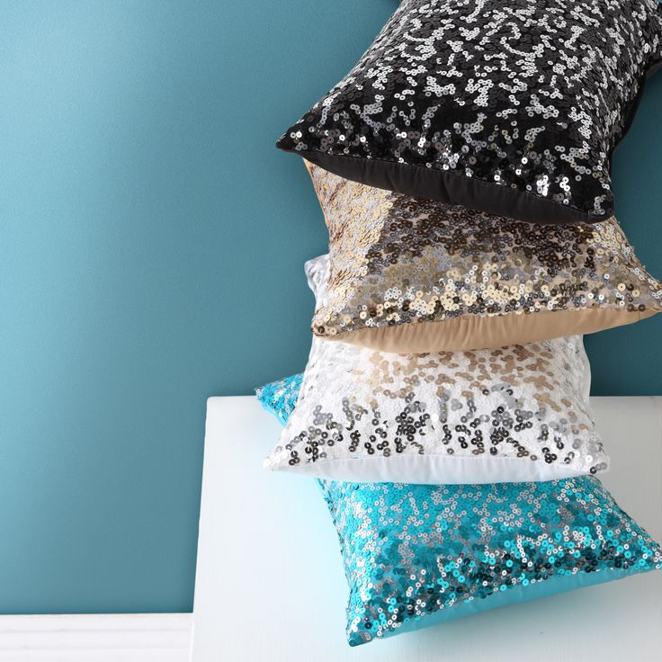Tivoli brunch cushions (30 x 40 cm), bring the bling home. An elaborate display of large, colourful sequins are interspersed with small contrast sequins over a faux satin base and plain reverse. Available in aqua, black, silver and new gold. #loganandmason