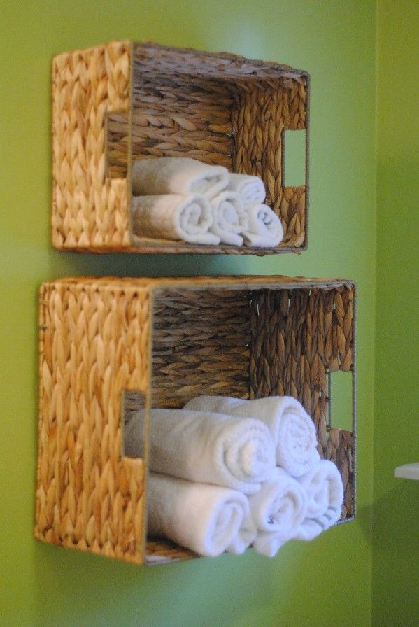 Wicker baskets look great in the bathroom. In fact, you can mount them on the wall and have instant towel storage. 30 Brilliant Bathroom Organization and Storage DIY Solutions - http://www.diyncrafts.com/2621/home/30-brilliant-bathroom-organization-and-storage-diy-solutions/11