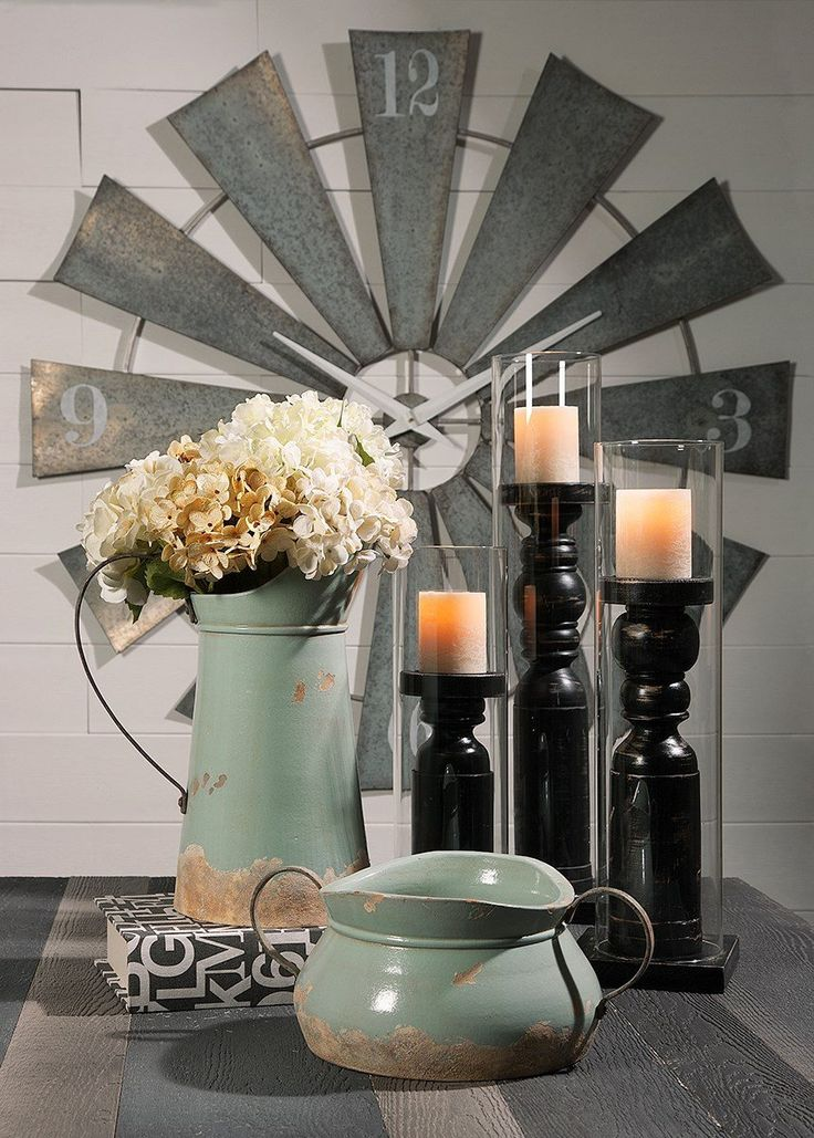 "This windmill wall clock has become a staple in any and all farmhouse fresh homes!!    Dimensions: (48""d x 1.5"")  Materials: 100% Iron  No assembly required  Clock Type: Wall  Battery Type: AA  Number of Batteries: 1  Batteries Included: No"