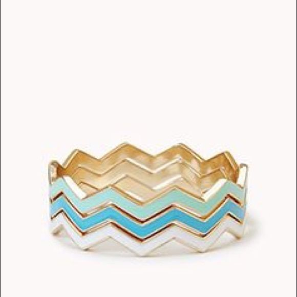 3 chevron multi color zig zag bangle bracelets 3 chevron multi color zig zag bangle bracelets! So cute. Blue/mint/cream/gold. 3 separate bracelets which can be worn together or separately. Missoni style Forever 21 Jewelry Bracelets