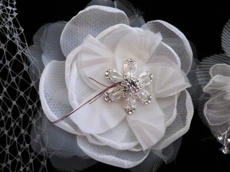 Bridal accessories including 2 face veils, 2 Bride pins, 2 Maid of Honor pins, 2 large clip on brooches, 4 comb headpieces, 4 circular headpieces, 1 headband. Most new with tags.