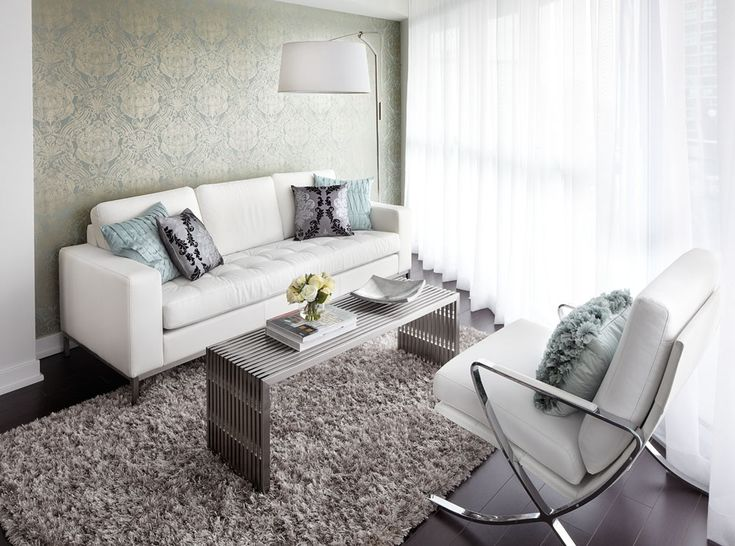 Contemporary Condo Living Room With White Leather Sofa Overhanging Floor Lam